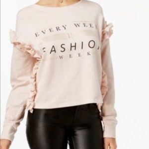 Pink cropped Fashion Week long sleeve top